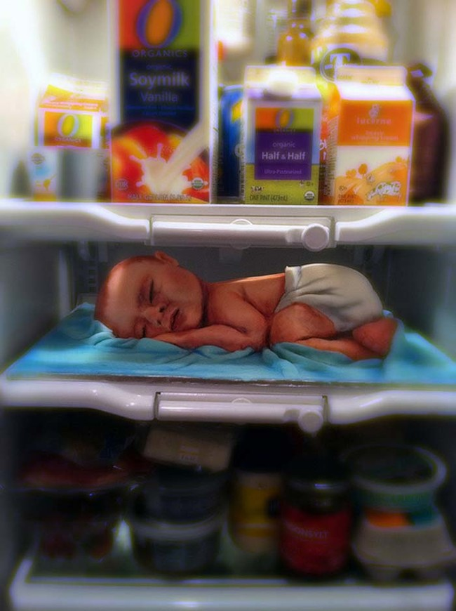 Baby asleep in the refrigerator