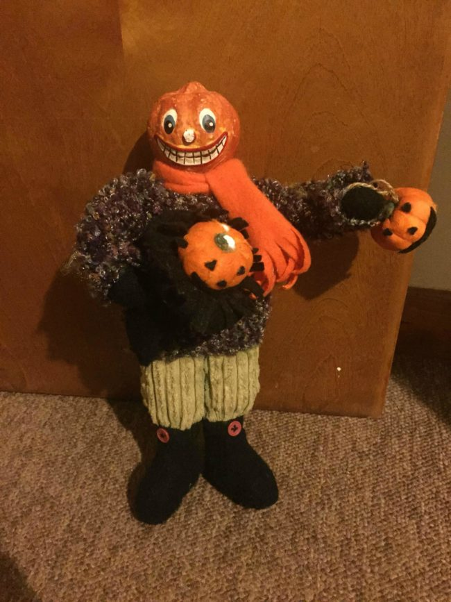 Wait, if he's a pumpkin man, is he holding the disembodied heads of his kin?