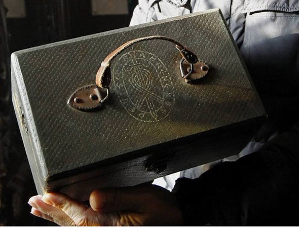 But it wasn't until recently that conspiracy theorists tied these skulls to the Nazis. This briefcase was recently found by a hermit near the cave, and it's decorated with the symbol of the SS Ahnenerbe.
