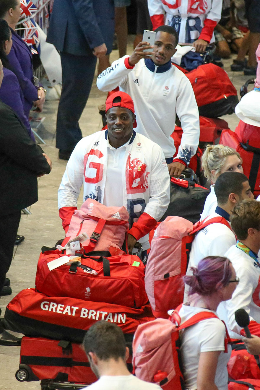 british-olympic-athletes-red-bags-heathrow-airport-9
